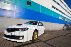 White sport car on background industrial building Stock Photo