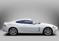 White sport car on grey background Royalty Free Stock Image