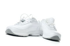 White sport shoes. Isolated on a white background Stock Photos