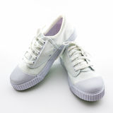 White sport shoes on white background. Stock Photo