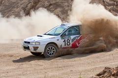 White sportcar Subaru Impreza on rally Royalty Free Stock Images