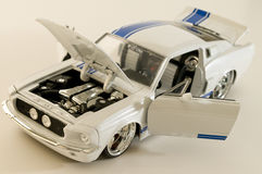 White sports car. Picture of a toy car. Focus is centered around the engine area Royalty Free Stock Photography