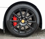 White sports car wheel. Royalty Free Stock Photo