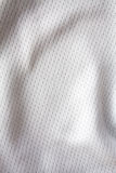 White sports clothing fabric jersey Royalty Free Stock Photo