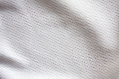 White sports clothing fabric jersey. Texture Stock Image