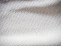 Sports jersey fabric texture background. White sports jersey fabric texture background Stock Image