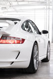 White sportscar. A detail shot of a white sports car within a brightly lit warehouse Royalty Free Stock Images