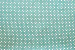 White spot on blue cotton Royalty Free Stock Images