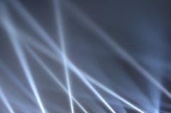 White spot light rays. Spot light rays on blue night scene Stock Photo