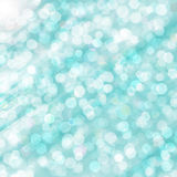 White spots on blue background. Bright glowing blue abstract background in the form of bokeh Stock Photos