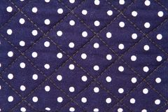 White spots on blue cloth Stock Image