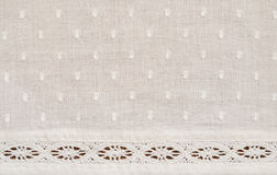 White spotted fabric. Background of spotted fabric with a strip of lace Royalty Free Stock Images