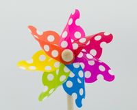 A white spotted  toy windmill stock image