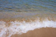 White spray. On the beach Royalty Free Stock Image