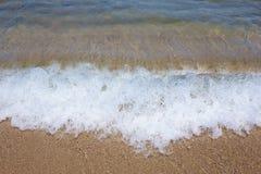 White spray. Splashing on the beach Royalty Free Stock Images