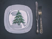White square ceramic plate with cutlery. And Christmas decorations, top view Stock Photos