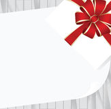 White Square Gift Box with Red   Bow on Wooden Plank Background with White sheet of paper. Stock Photography