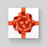 White Square Gift Box with Shiny Orange Ribbon Bow Royalty Free Stock Photography