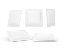 White square heat sealed packet with clipping path. White square heat sealed packet  with clipping path. Packaging  or wrapper for sweet, snack, milk bar, coffee Royalty Free Stock Images