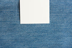 White square label. On top of light blue jeans texture Stock Photo