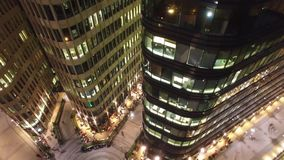 White square modern business center. Moscow Russia. Night illumination. Office windows. Steel and glass reflections. Unique aerial shot. Office windows. Steel stock footage