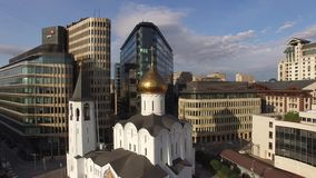 White square Moscow city. Unique mix of modern and old Russian architecture. Glass and steel office buildings. Orthodox church dom. Aerial close flight over. 4k stock video