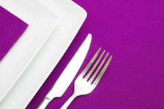 White square plates and mauve napkin Stock Images