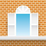 White square window orange brick home wall and blue sky background. Stock Photo