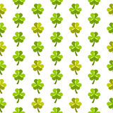 White st patrick's day seamless pattern with shamrocks. White flat style st patrick's day seamless background with repeated bright green shamrocks Stock Image
