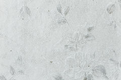 White stained wall texture with flowers Stock Image