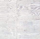 White Stained Weathered Plywood. Soft white toned plywood panels showing the wood grain pattern Royalty Free Stock Photo