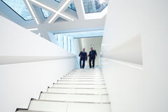 White staircase with business people Stock Image