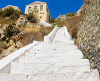 White staircase leading up the hill to the house Stock Photos
