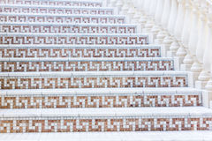 White stairs with mosaic tile with balusters. Abstract architecture interior fragment Royalty Free Stock Images