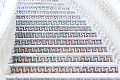 White stairs with mosaic tile with balusters. Abstract architecture interior fragment Stock Photography