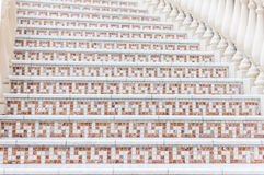 White stairs with mosaic tile with balusters. Abstract architecture interior fragment Stock Photos