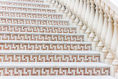 White stairs with mosaic tile with balusters. Abstract architecture interior fragment Royalty Free Stock Photo
