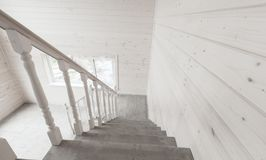 White stairway railings. Empty wooden house. White stairway railings. Empty new wooden house interior fragment Royalty Free Stock Photos