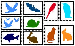 White stamps with animals. Ten stamps with white background and colored animal silhouettes. Available as Illustrator-file Royalty Free Stock Photography