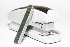 White stapler with a black stripe on a white background rnat the side royalty free stock photo