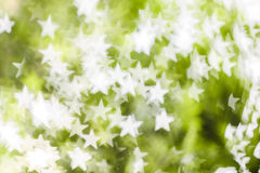 White star bokeh on green background Royalty Free Stock Photography
