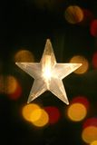 White star light. With a coloured lights background Stock Images