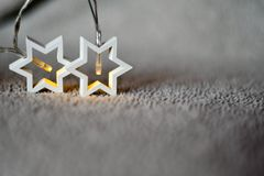 Christmas greeting card background. White  star  lights  on traditional white background Royalty Free Stock Photos