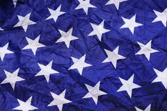 White star on screwed blue silk texture. Part of USA flag Royalty Free Stock Photos