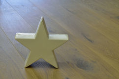 White star. On wooden floor Royalty Free Stock Photo