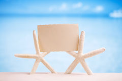 White starfish with blank retro photo on white sand beach, sky a Stock Photography