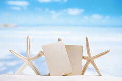 White starfish with blank retro photo on white sand beach, sky a Royalty Free Stock Photography