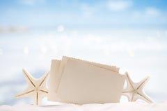 White starfish with blank retro photo on white sand beach, sky a Royalty Free Stock Photos