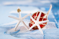 White starfish with red Glass float Stock Photos