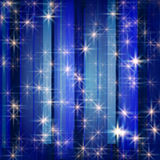 White stars in blue. White stars and snowflakes over blue background striped Stock Image